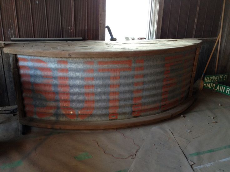 Repurposed barn beam and grain silo panel. Would be an awesome outside bar by the pool.