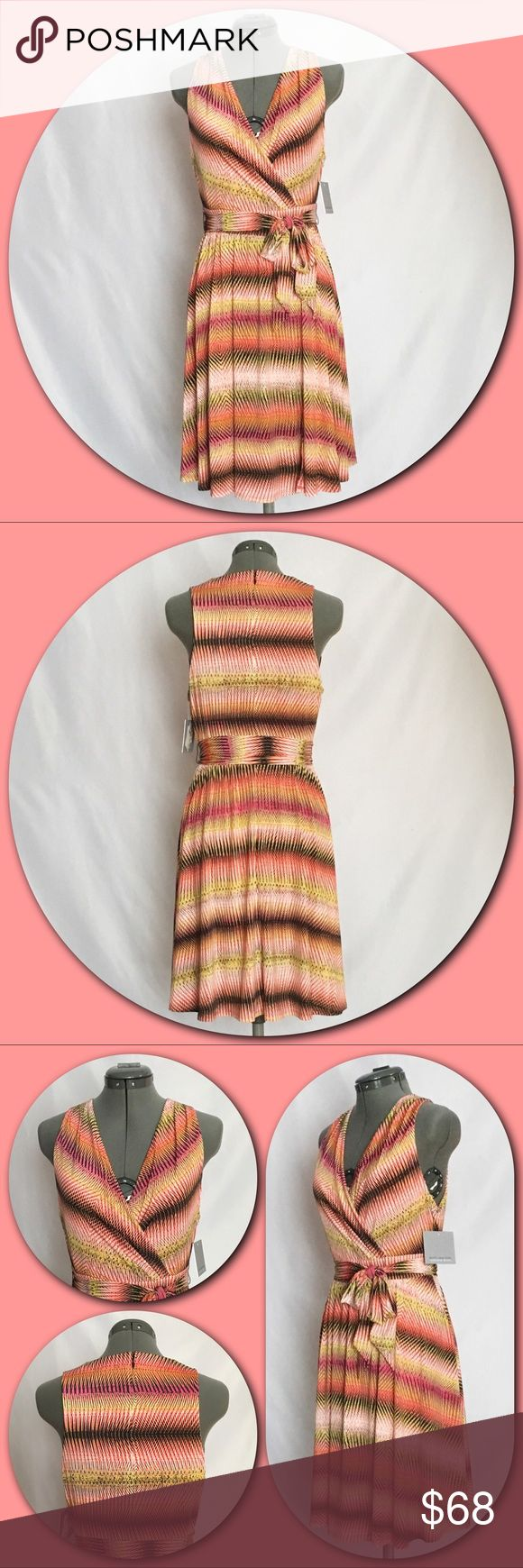 """Marc New York - Andrew Marc 💕Faux Wrap Dress💕 Marc New York - Andrew Marc 💕Vibrant Faux Wrap Dress. Multi-colored cross over V-neck with pleats at the shoulders and waist. Self tie at the waist with a split wrap around skirt. Hidden back zipper, fully lined. Lining fabric only has a small hole/run by the neck label which does not go through to the dress fabric. Picture #4. Approximate measurements taken lying flat with no stretch. Bust - 17"""" armpit to armpit. Waist - 15"""" side to side…"""