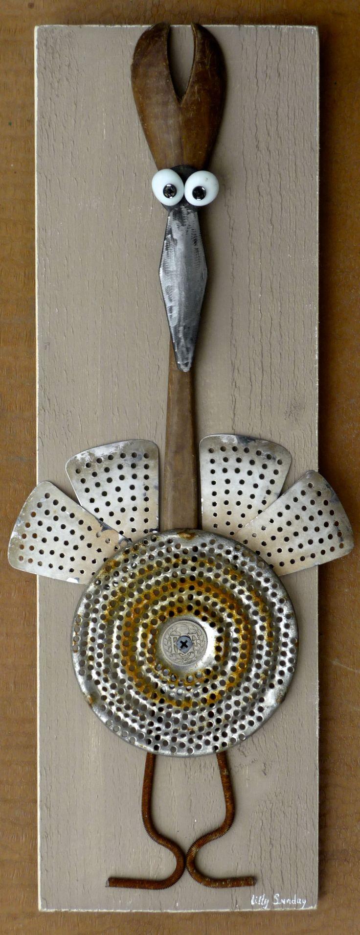 Wonderful bird made from old kitchen utensils, I love it!