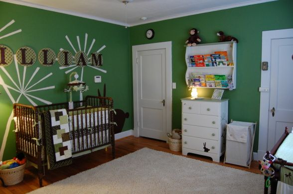 green nursery- I like the mismatched furniture and the book shelf. also the wall decals