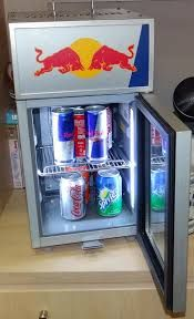 The red bull mini fridge has a heating and cooling mode. Obviously most of the time you would want to keep it on cooling but heating is still a nice option to have. It has a rack that can be taken in and out depending how many drinks you want to store. It could hold a total of up to 8 drinks and it keeps them very cold.