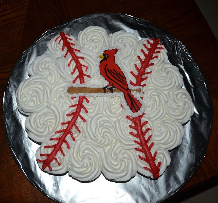 Cardinals baseball cupcakes cake..would be cute in team colors or without the cardinal just a ball!