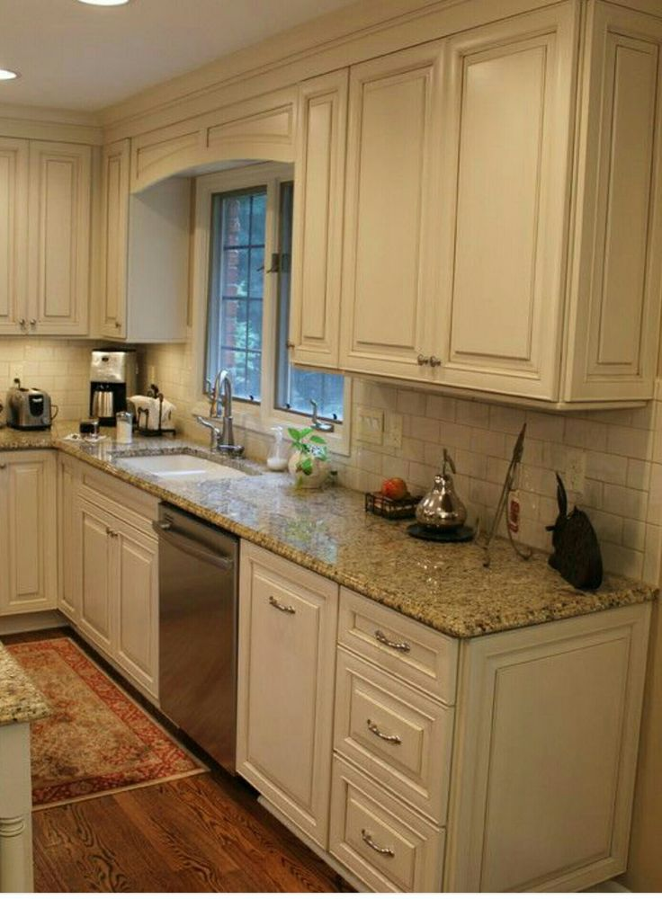White cabinets, subway tile, beige granite countertops