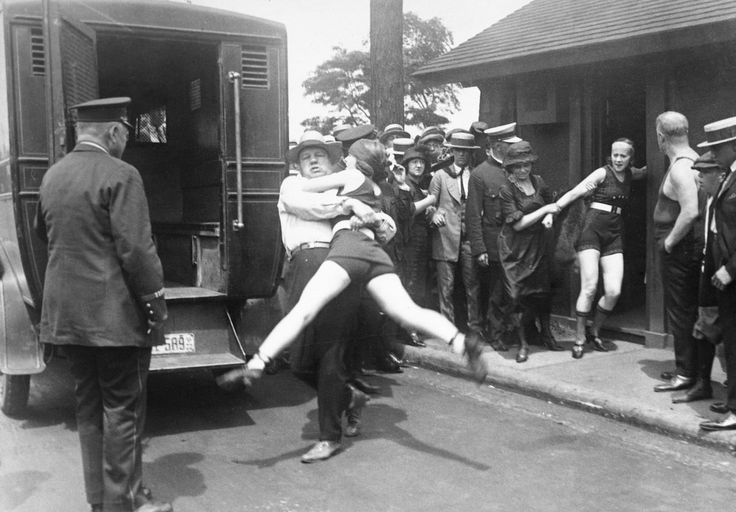 """July 12, 1922 A woman is arrested for defying a Chicago edict banning """"abbreviated bathing suits"""" on beaches"""