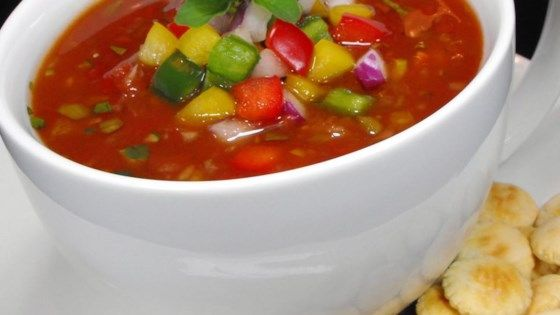 A wonderful cold savory soup made with tomatoes, cucumber, green and red bell peppers, and seasonings won't heat up the kitchen on those hot summer days. Garnish with fresh parsley, chives, dollops of sour cream, and toast.