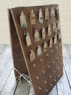 For small earrings: cup hooks on a hinged board (or a board in a picture easel/ with an L-bracket backing).