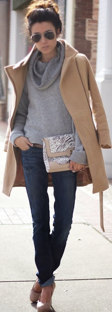 Camel coat over gray sweater, jeans with nude heels and aviator sunglasses.