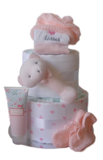 Two Tier Nappy Cake Knitted by Nanna    $79.00  26 Huggies Newborn Nappies  1 Cotton face washer  1 Fine Strip Bib  1 Striped Bear Rattle  1 Hand Knitted Beanie and Booties set  1 Strawberry Shortcake Hand Cream 100ml  1 Heart Cotton Wrap 120 x 120cm  1 White Cotton Wrap 120 x 120cm