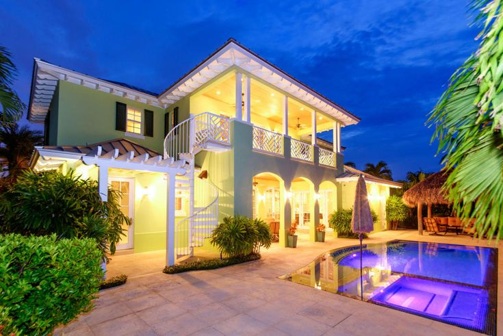 Perfection is the only way to describe this custom-built, waterfront Key  West-style home! Listed bySharon Keeler Gisriel, the stunning  residence is in North Palm Beach Village.  🔹4 bedrooms 🔹6 full baths & 2 half baths 🔹Gorgeous perimeter overflow pool w/private dock 🔹CBS Construction 🔹Waterfront w/deep water access