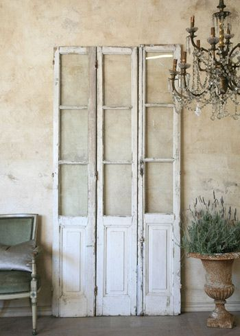 vintage door find, aged patina of creamy white w/touches of pale grey.perfect as a room divider, or wall piece with clear window panes