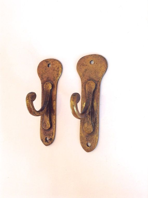 Two antique brass wall hooks £16.80