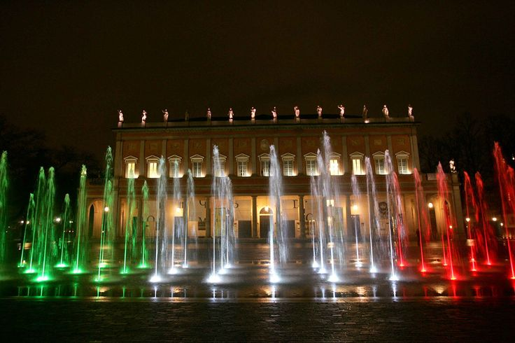 REGGIO EMILIA is the city where the 3-colors Italian flag was born in 1797. And the green-White-red colors decorate many places in the city. Here in the picture a game of colors for the fountain in front of the Valli theater!