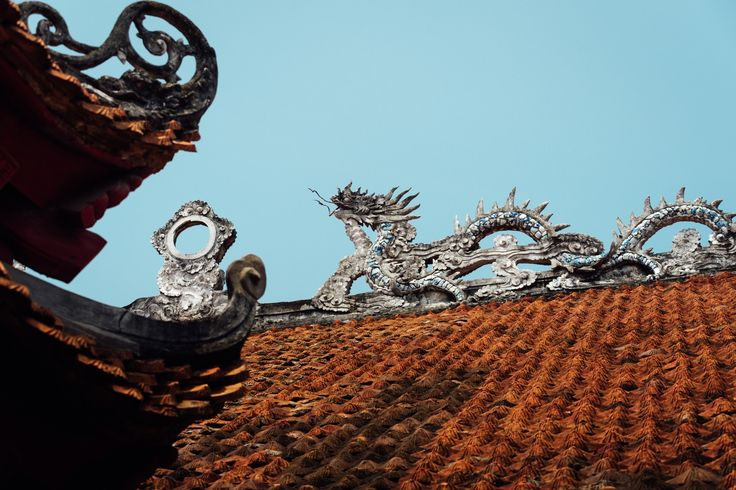 Van Mieu Dragon - One of the many dragon ornament at the temple of literature, or văn miếu in Hanoi, Vietnam.