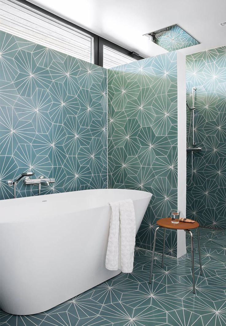 Untraditional yet beautiful bathroom with modern bathtub and stunning tiles.