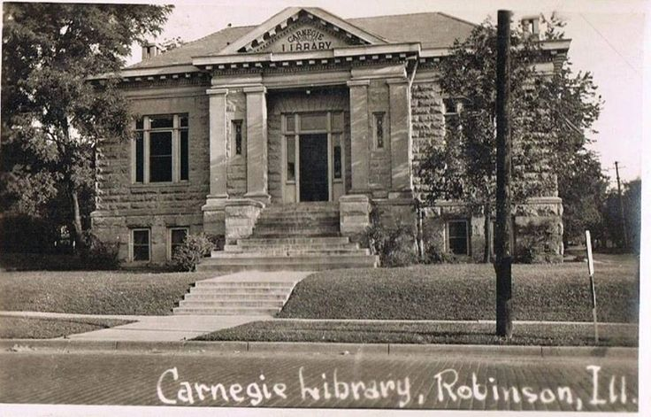 Carnegie Public Library on East Main St in Robinson, Illinois.  Note that Main St was a brick road at the time of this picture.