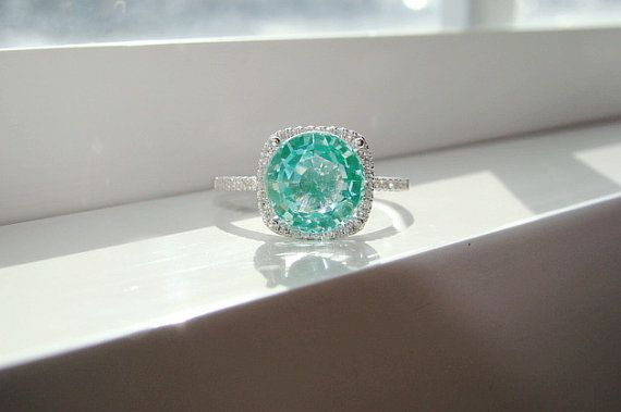 Large Halo Mint Green Paraiba Tourmaline Diamond by PenelliBelle.  This looks like the water in Haiti and Jamaica.  So beautiful.