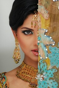 I want a Sari and all the gorgeous gold jewlery Indian women wear!