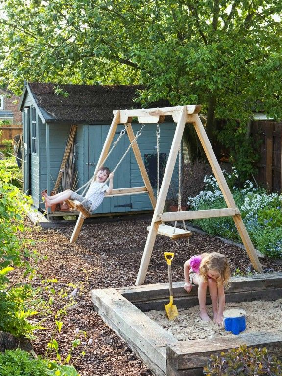Swings and sandpit - part of a family garden featured on intoGardens (into-gardens.com)