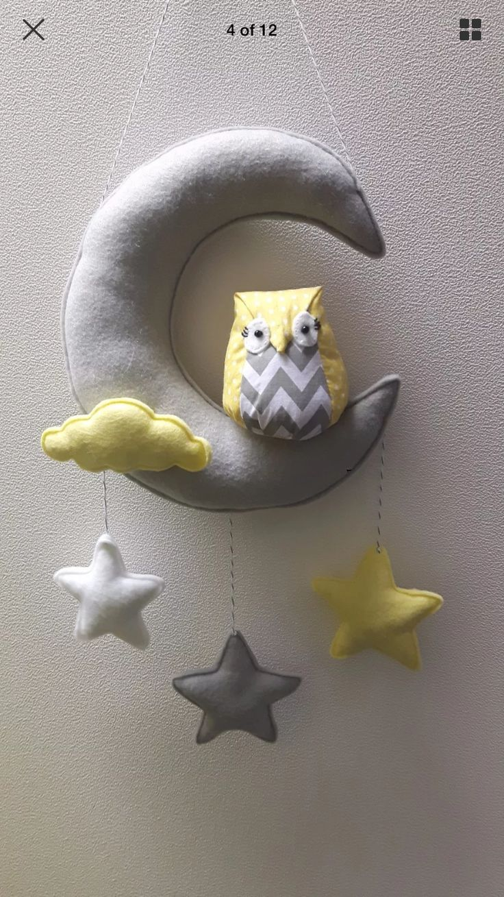 Love this grey and lemon owl nursery decor which is on the wall in baby Smiths room!