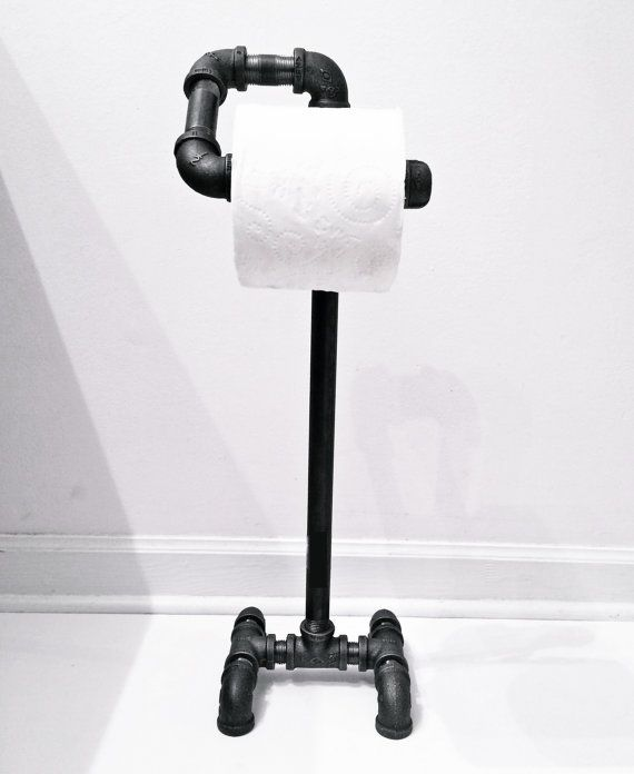 Industrial toilet paper holder/stand made from unfinished (unless otherwise requested) black iron pipe fittings with a natural gunmetal color.