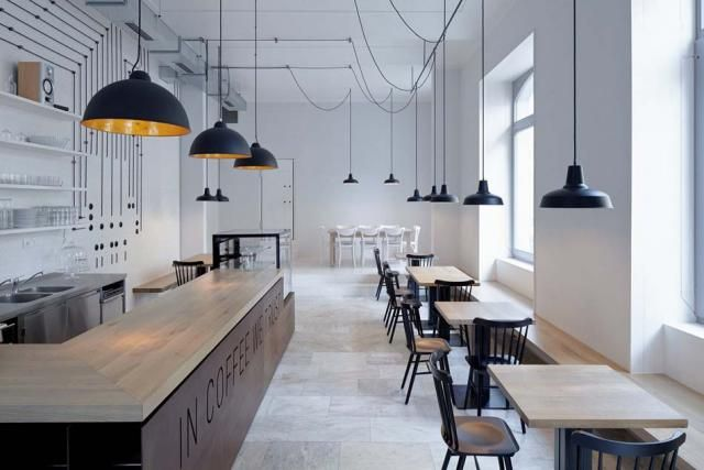 Simple furniture, white walls with only black cables sketching amusing lines for decoration, it must be said that this Prague Bistro cafe intrigues & attracts attention.