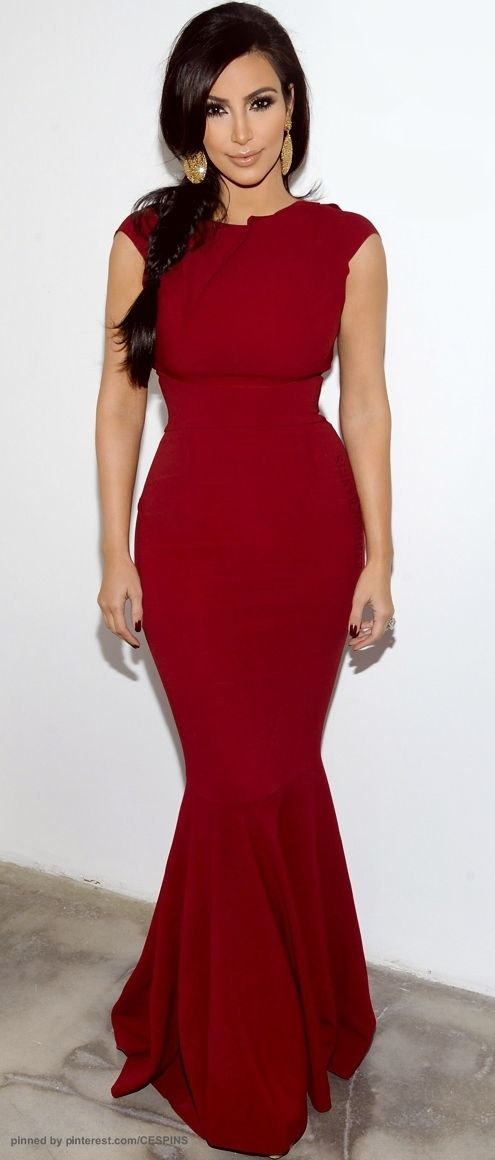Don't like Kim K much but this dress is amazing. Floor length, small cap sleeve, very fitted red dress.