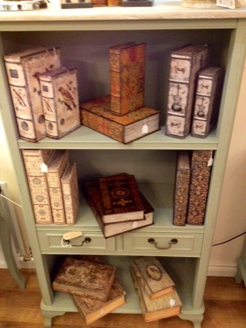 orchard bookcase holding book boxes, these hollow book effect boxes are fantastic for holding secret trinkets! Very alice in wonderland!