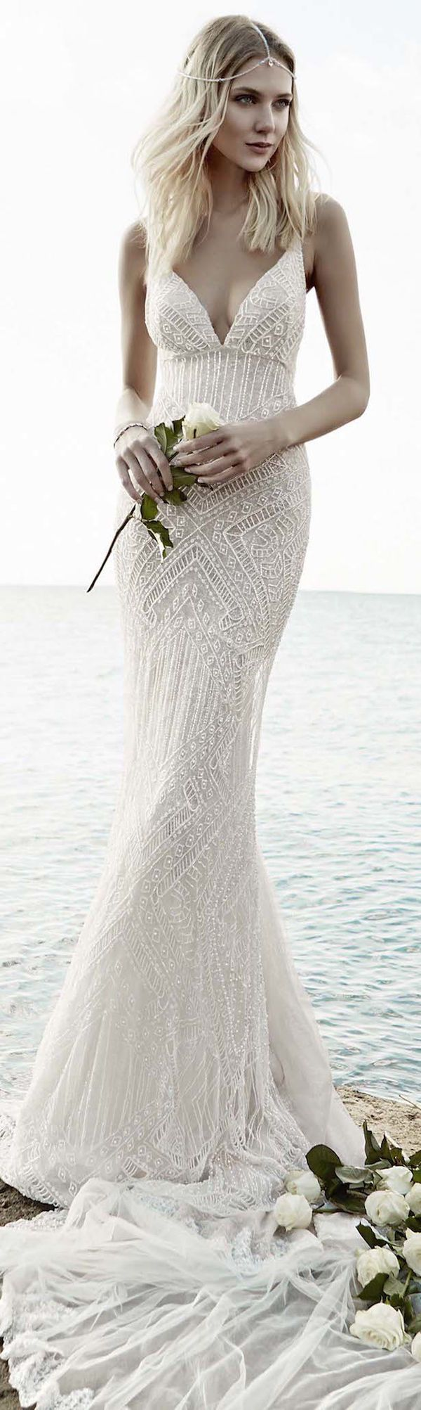 If you love simple dresses but are afraid of being a forgettable bride, keep the cut classic while indulging in the detailed fabric trend. Whether it's stitching, beading, or embroidery, add some pizzazz without taking away from your timeless bridal look.