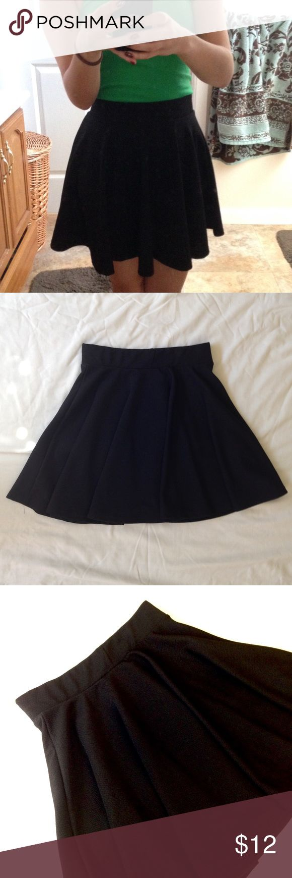 """Black circle skirt A black skirt great for any occasion! Full circle skirt with an elastic waistband and great swish! Waistband unstretched: 12"""". Length: 16"""". ❣Make an offer!❣❌No Trades❌ Kathy Skirts Circle & Skater"""