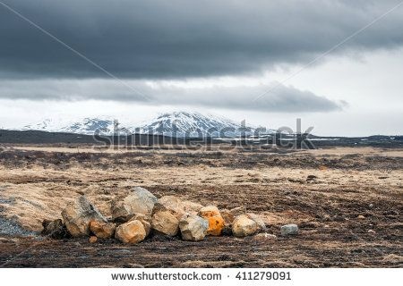 Landscape with rocks and mountains in cloudy weather