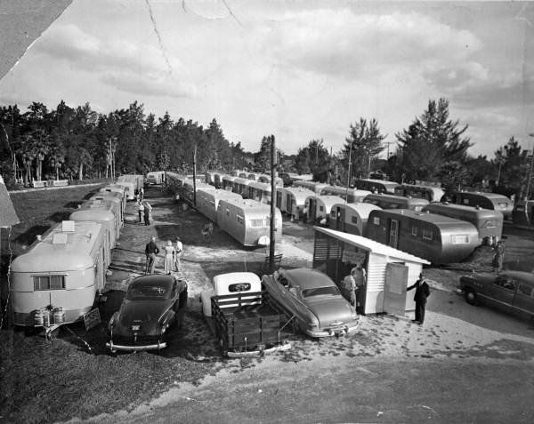 TCT Convention in Tampa in 1949. This picture is of the area set aside for Trailer Dealers! Besides being a typical rally get together, the TCT Rallies back in the day would have MANY trailers set up by dealers and companies showing the new models of trailers being produced! The cars in the photo were likely the vehicles used to pull all of these trailers! They all have heavy duty hitches on the back!