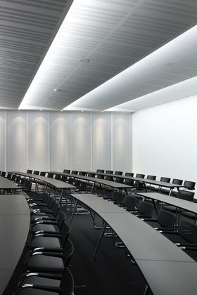 Corporate Training Room- slight curve in tables- makes space interesting- Black countertops vs. white will look cleaner longer