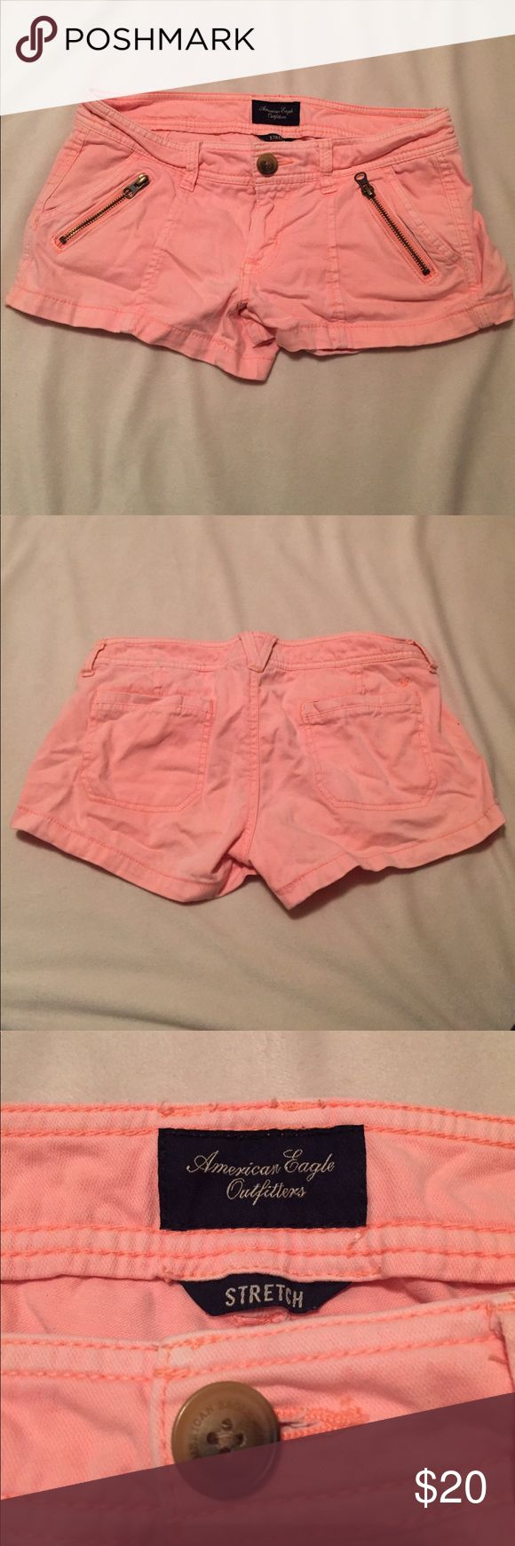 Size 4 Hot Peach American Eagle Outfitters Shorts These hot peach shorts are stretch by American Eagle Outfitters. Zippers are just accent decorations, but there are two pockets in the front and two in the back. In good condition. A perfect pop of color for the summer time. 98% cotton 2% spandex. American Eagle Outfitters Shorts