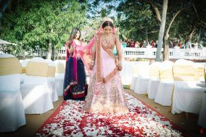 #Bride a coral #pink and #gold #lehenga by #NeetaLulla #destinationwedding #Leela #Kovalam