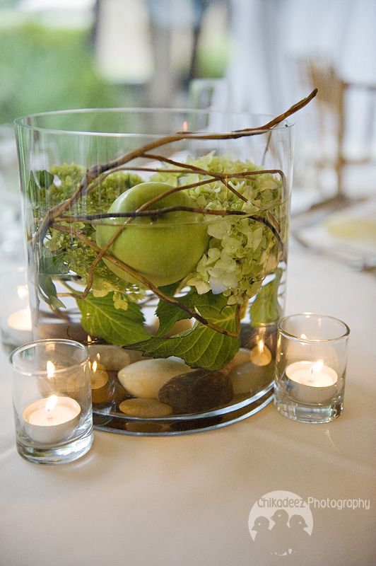This centerpiece above had gold wire and green cymbidium orchids swirled through and submerged with floating candles.  A lush mix of matching petals and tea light votives surrounded the centerpiece.