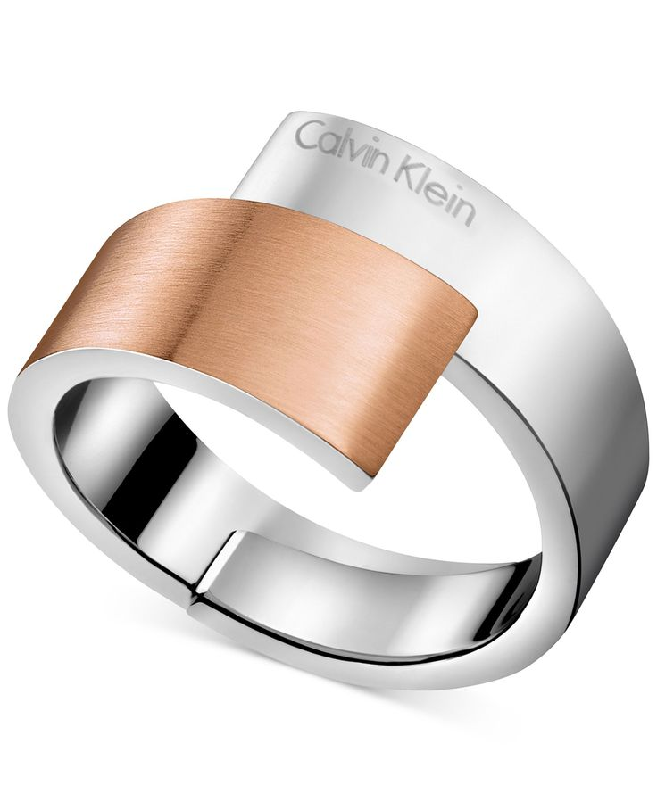 Calvin Klein's bypass ring exudes a cool, sleek feel with a open silhouette in two-tone polished stainless steel and rose gold-tone mixed metal. Size 5, 6, 7, 8 and 9. | Photo may have been enlarged a
