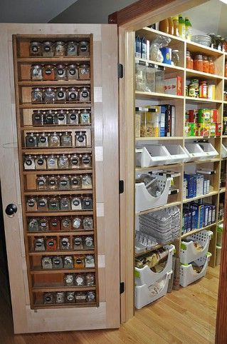 60+ Innovative Kitchen Organization and Storage DIY Projects - A place for everything in this pantry with awesome door storage. Organizing means utilizing every bit of space that you have. Use pegboards to hold things that can hang, baskets for groups of items and even the inside of your pantry door as a spice rack. Large pots can be stored on floor space below the bottom shelf and small bins are perfect for holding snacks and other items.