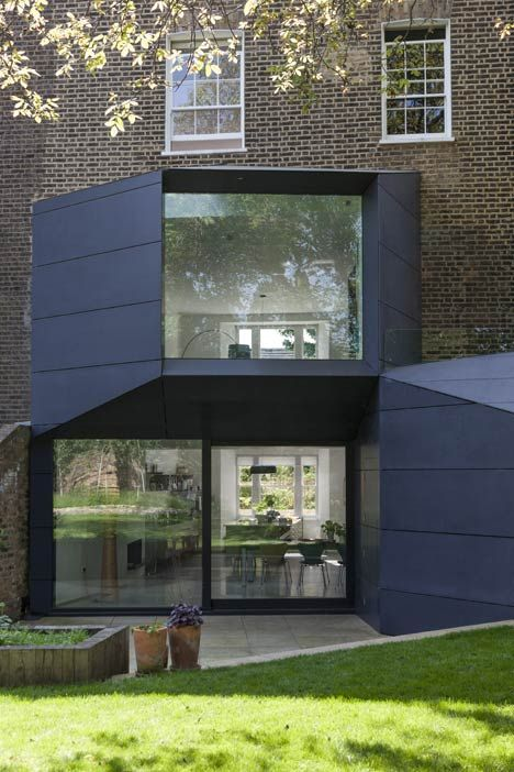 Extended 19th century house, North London - two tapered volumes added to create two new rooms by Alison Brook Architects.