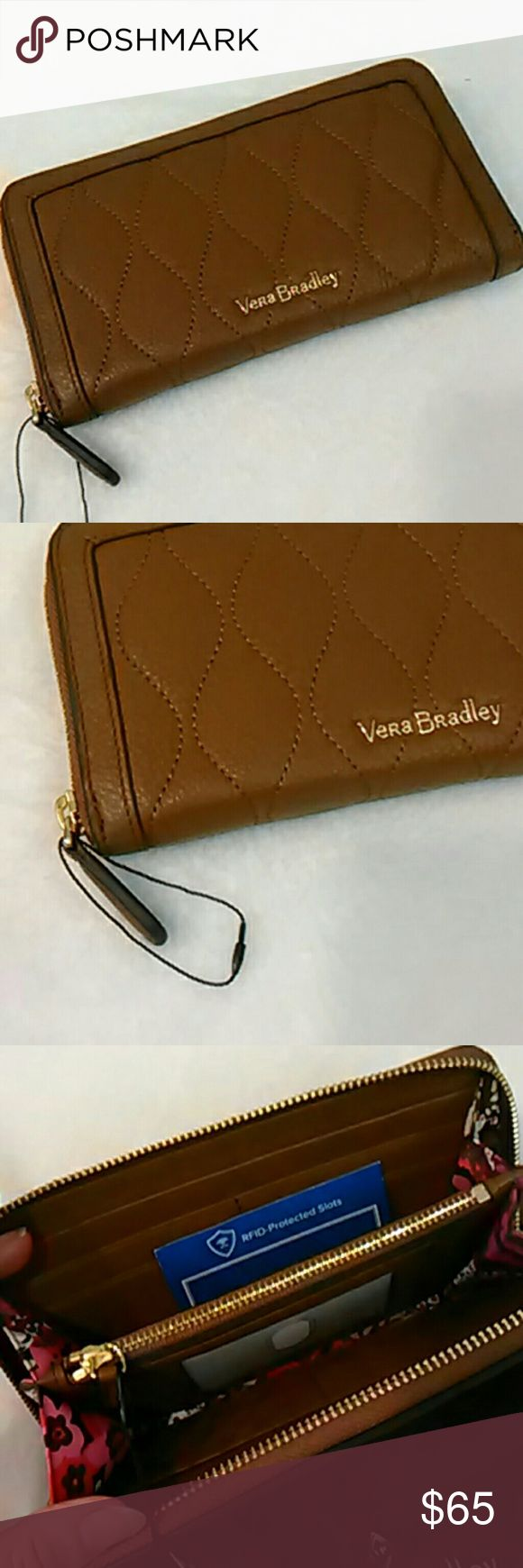 RFID wallet Georgia genuine quilted leather Brand new with tags, this is an RFID protected genuine quilted leather Georgia style wallet by Vera Bradley in cognac.  It zips open to reveal clear ID window, 8 card slips, 2 bill slips and a large zip pocket.  Comes with dustbag, as do all my Genuine leather Vera Bradley items.  I have some matching bags available too. Vera Bradley Bags Wallets