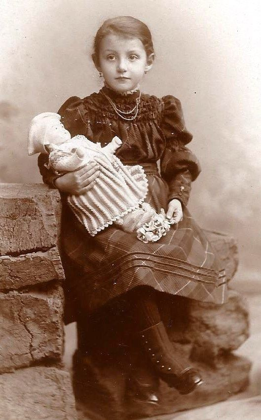Classic photo of little girl with her doll.