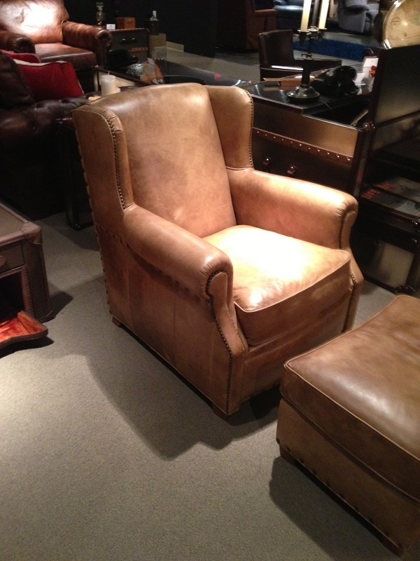 Light brown leather chair with nailhead trim by Flexsteel Furniture. // www.KeyHomeFurnishings.com
