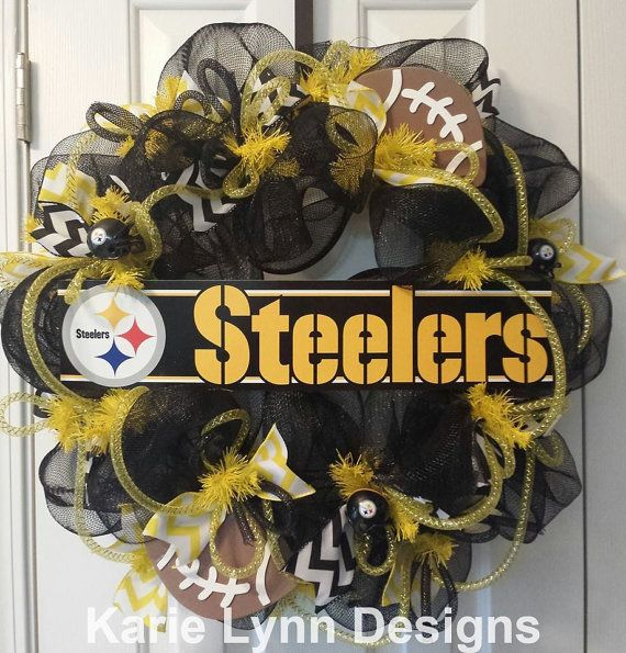 This is a black deco mesh wreath with yellow and white accents. Also has Riddell mini steelers helmets. GO Steelers!!  This wreath measures