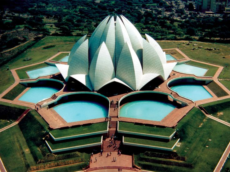 The Lotus Temple in Delhi, India. This Bahai House of Worship has nine doors and nine surrounding ponds. Around 4 million tourists visit it every year.