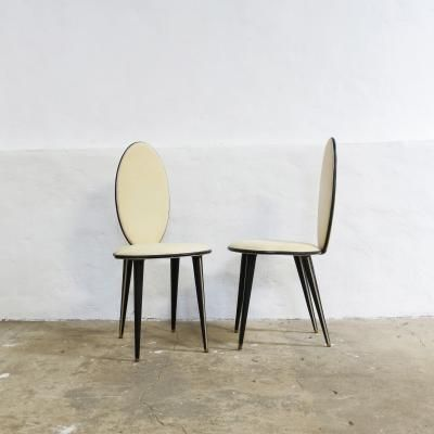 <div>These dining chairs were designed in Italy by Umberto Mascagni, during the 1950s. The chairs are made of beige leatherette and black tapered legs on brass feet, which are removable. In 1952 Mascagni created a new line of furniture using new materials and was retailed through Harrods, London in the 1950s. In very good condition with light wear commensurate with age.</div><div><br><b>This item is shipped from Portugal, please enquire about shipping costs ...