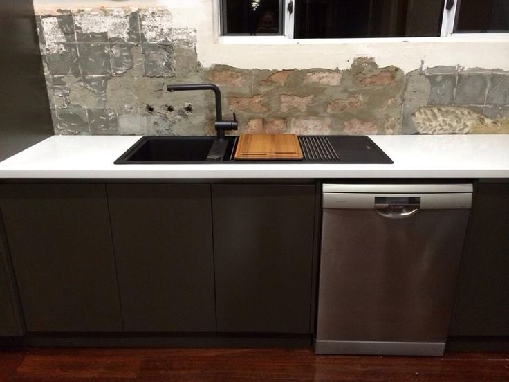Stone benchtop with grey satin painted finger grip doors and Fragranite sink