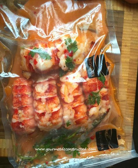 Lobster poached in sous vide bag~Set up a sous vide bath at 140 degrees. Remove the lobster meat from the tails and put the shells to the side for later. Place the butter, chili paste, garlic, and herbs into a sous vide bag. Season the lobster with a litt