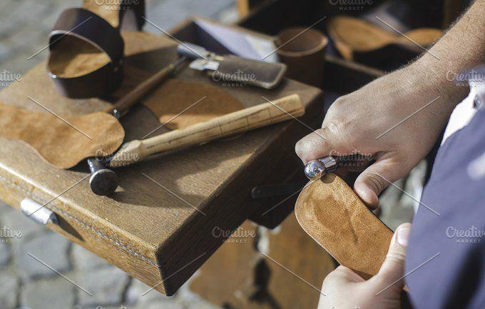 Hands making shoes by Deyan Georgiev  on @creativemarket