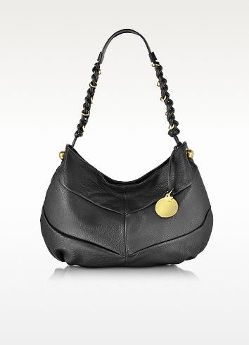 €435.00 | Madie Black Leather Hobo crafted in natural grained calfskin, has that droopy hobo-chic style with a roomy interior that's perfect for your daily essentials and transitions from day to evening. Featuring magnetic snap closure, single shoulder strap with twisted leather and gold ring detail, two internal compartments, center zip pocket, two open side pockets, external side ball ornaments, detachable hanging logo detail and gold tone hardware. Signature dust bag included.
