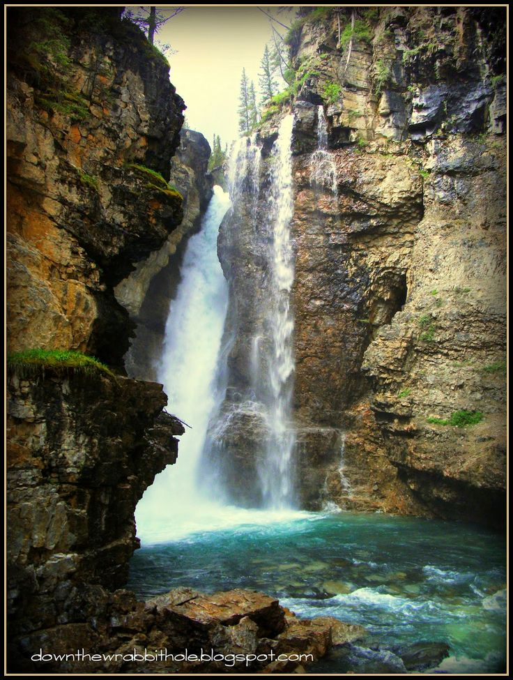"The majestic Upper Falls of Johnson Canyon in Banff, Alberta. Find out more at ""Down the Wrabbit Hole - The Travel Bucket List"". Click the image for the blog post."