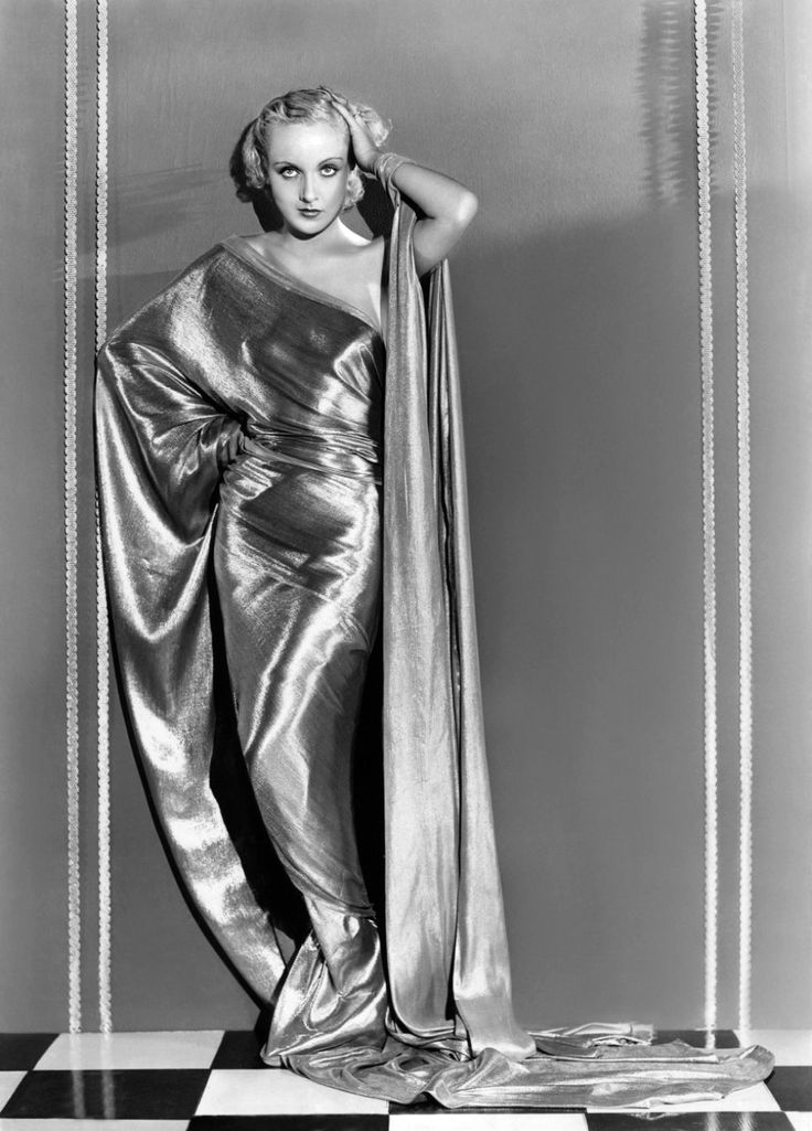 Carole Lombard knew how to wear an off-the-shoulder dress and strike a pose.